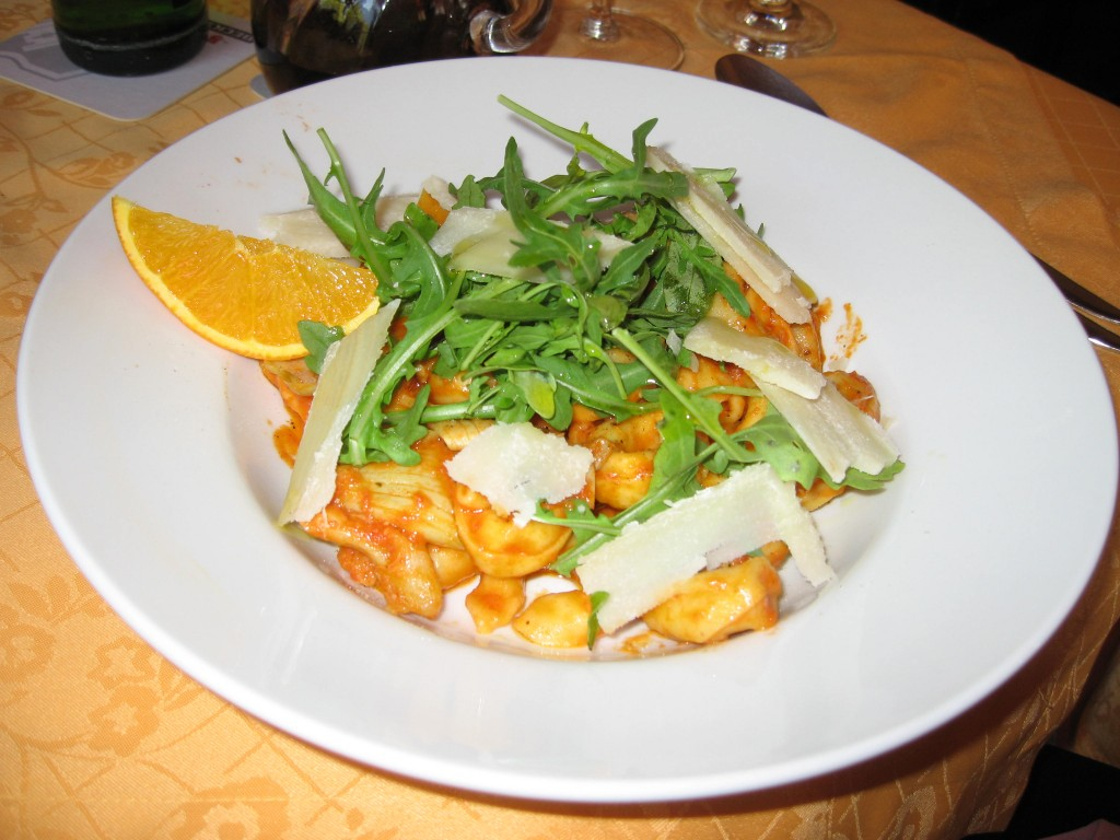 Tortellini with tomato artichoke sauce