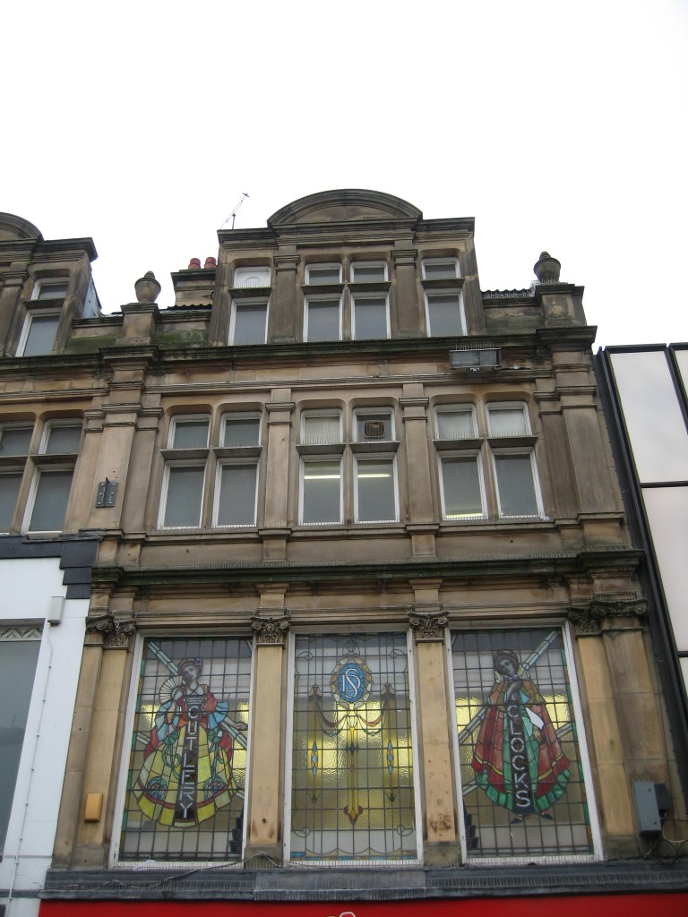 Victorian building with stained glass windows